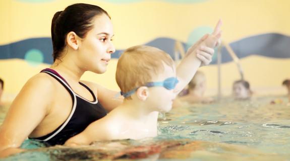swim instructor with child