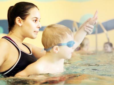 swim instructor with child