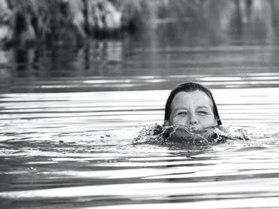 woman swimming in water