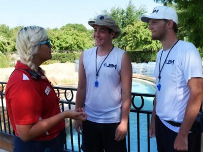 JEM lifeguard instructor talking with lifeguards