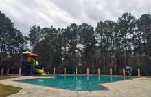 Atascocita Shores pool, waterslide and lifeguard chair