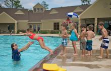 Swimming instructor teaching class at Benders Landing Estates