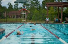 Children swimming laps in Benders Landing Estates pool