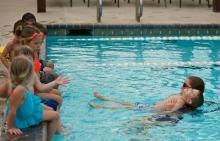Children learning how to swim at Benders Landing Estates pool