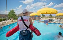 Lifeguard scanning water at Liberty Grove pool