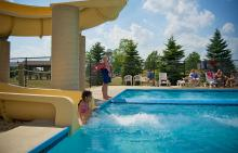 Child sliding down waterslide at Liberty Grove pool