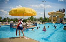 Lifeguard scanning water at Liberty Grove pool