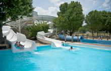 Children coming down water slide at Phillips Park Family Aquatic Center
