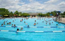 Lifeguard scanning pool at Phillips Park Family Aquatic Center