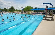 Lifeguard monitoring swimmers at Phillips Park Family Aquatic Center