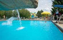 Lifeguard monitoring drop-off pool at Phillips Park Family Aquatic Center