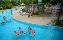 Kids on inner tubes going around lazy river pool at Splash Country Water Park